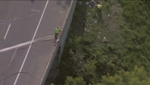 Raw video: Aftermath cleanup of car rolling over on highway 400 bridge