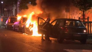 Demonstrators in Paris burned multiple vehicles in election night protests