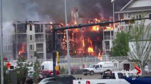 Fort McMurray apartment building engulfed in flames
