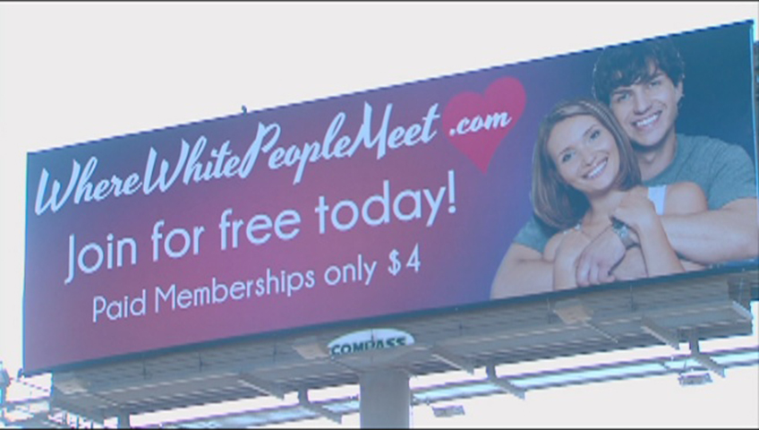 Billboard for dating website targeting only white and straight people is removed from Utah roadside after storm of complaints