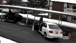 Security camera shows man fleeing police steals car with children inside