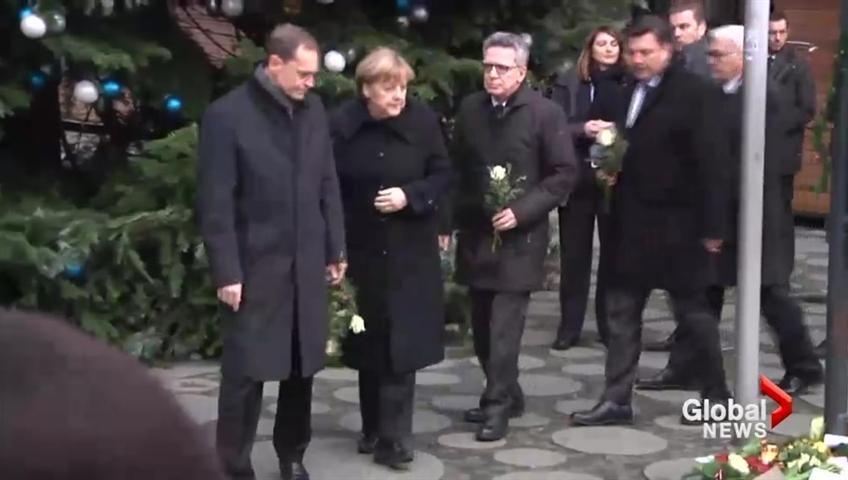 http://i1.wp.com/media.globalnews.ca/videostatic/27/663/Merkel_lays_flowers_at_Xmas_market_qtp_848x480_837552707845.jpg