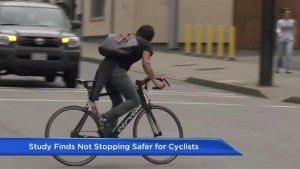 Study finds not stopping safer for cyclists