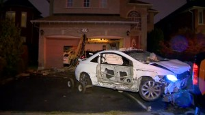 Aftermath of car crashing into Mississauga home