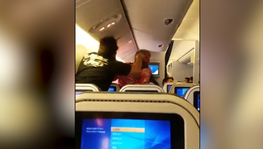 Passengers BATTER each other on ANA airlines plane in shock video