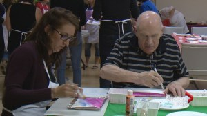 Art therapy program pairs seniors with dementia with young volunteers