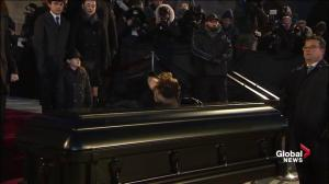Celine Dion kisses the casket of René Angélil