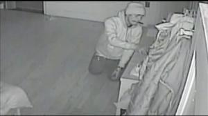 NYPD release disturbing video showing burglar crawling into family bedroom as they sleep