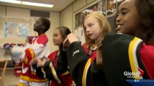Calgary students sing on the Flames