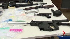 Firearms, cash and drugs seized