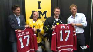 Prince Harry and Justin Trudeau get Team Canada jerseys from sledge hockey team