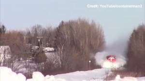 CN train plows through heavy snow in New Brunswick