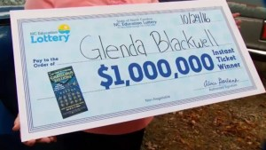 Woman buys scratch ticket to show husband they're pointless – and wins $1,000,000