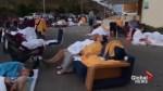 Travellers in Greece sleep on beach, poolside following earthquake