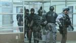 Toronto police launch pre-dawn raids across the city