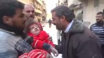 Little girl pulled alive from the rubble following airstrike in Syria