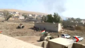 Kurdish Peshmerga fighters run through heavy gunfire during Mosul offensive