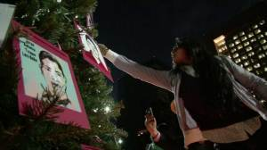 Mexicans decorate Christmas tree with faces of 43 missing students