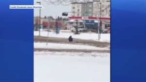Man with firearm shot by Edmonton police