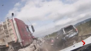 Dramatic dashcam video captures massive pile-up, drivers free woman from burning car