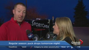 Former Calgary Flames' defenceman Mike Commodore helps celebrate the new NHL season