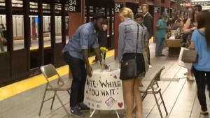 New York man looking for love sets up speed dating table at subway station