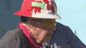 Former U.S. president Jimmy Carter at work site, says he's tired, escorted to ambulance