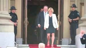 Rachel Notley emerges from the Alberta Legislature
