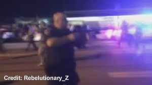 Police officer caught on camera pointing rifle and threatening protesters in Ferguson