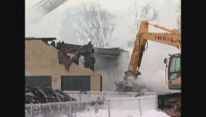 Archival footage of East Elmwood Community Centre being torn down after serious blaze