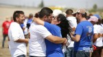 'Hugs not walls': Families separated by border hug it out at cross-border event