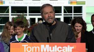 Mulcair insists NDP won't run deficit, will cut Conservative programs to stay within balanced budget