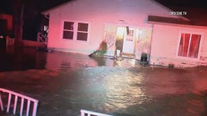 Flood waters trap residents in California while snow snarls northern regions