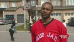 Vaughan family hooped over basketball net on street