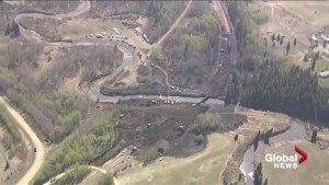 Aerial view of the aftermath of trestle bridge fire in Mayerthorpe