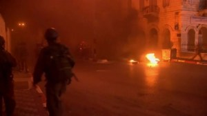 Raw video: Palestinian protesters scuffle with Palestinian police, Israeli troops