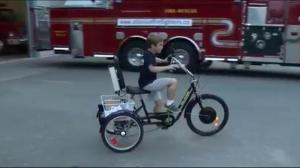 New modified bike for Elijah thanks to Mission firefighters