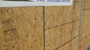 Businesses continue to board up windows in advance of Michael Brown decision