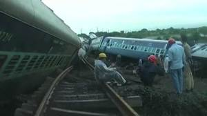Dozens dead after 2 trains derail in India