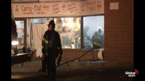 Baltimore firefighters comb through remains of burnt out corner store
