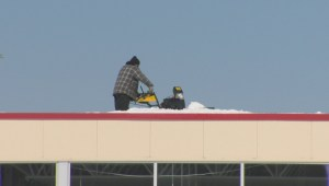 Snowblowers used to clear snow from roof of Canadian Tire