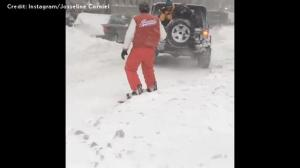 Pulled by a truck, man goes 'snowboarding' through snow-packed NYC streets