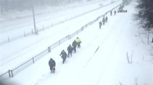 Commuters forced to walk after train gets stuck in snow in Massachusetts