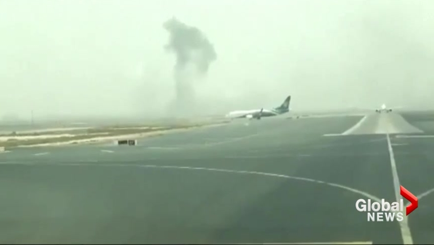 Footage shows confusion, fear inside smoke-filled Emirates plane
