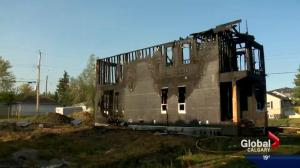 Calgary firefighters battle blaze at house under construction in Mount Pleasant
