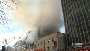 Mayor John Tory reacts to the 6-alarm fire in midtown Toronto
