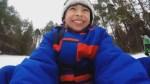 Syrian refugee children toboggan, experience snow in Ontario