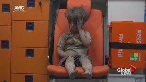 Young boy pulled from rubble of destroyed building in Syria
