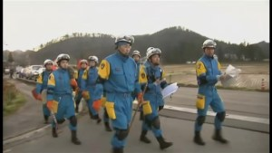 Emergency crews evaluate  damage after earthquake in central Japan