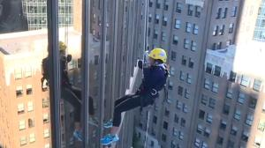 Sophie Lui rappels down the side of a building for Easter Seals